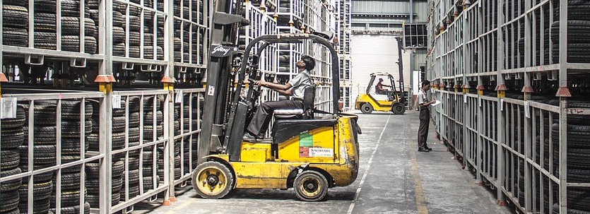 Yellow forklift truck in a warehouse.