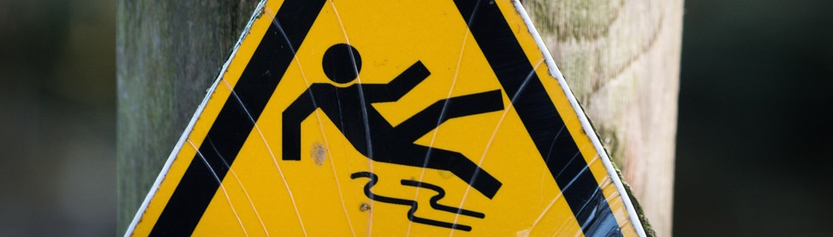 Sign of a man falling on a slippy floor.