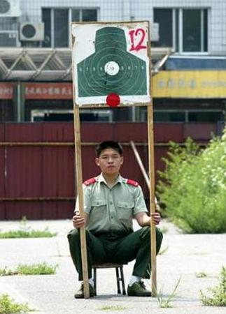 Soldier sits under shooting target